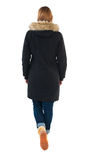 Back view of going  woman in parka. Stock Images