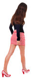 Back view of going  woman  in red dress. Stock Images