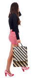 Back view of going  woman  in red dress. Royalty Free Stock Images