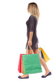 Back view of going  woman  with shopping bags Stock Photos
