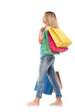 Back view of going  woman  with shopping bags Stock Images