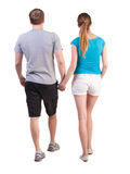 Back view of going young couple Stock Images