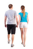 Back view of going young couple Stock Photo