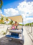 Back view of golf cart with father and his little Stock Photography