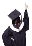 Back view of graduate finger point copy space Royalty Free Stock Images