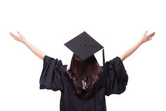 Back view of graduate student girl hug future. And look up to copy space, she wear graduation cap and gown ,asian woman Stock Image