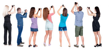 Back view group of people photographed attractions. Stock Images