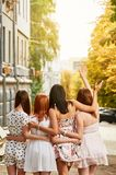 Best girlfriends hugging. Back view of group young best girlfriends hugging outdoors stock photos