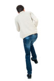 Back view of guy funny fights waving his arms and legs. Isolated over white background. Rear view people collection.  backside view of person. Curly short Stock Photos