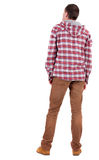 Back view of guy in a plaid shirt with hood looking. Standing young guy in jeans and jacket. Rear view people collection. backside view of person. Isolated stock images
