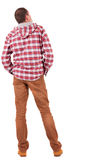 Back view of guy in a plaid shirt with hood  looking Stock Photography