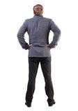 Back view of handsome business man in coat. Royalty Free Stock Images