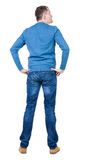 Back view of handsome man in blue pullover looking up. Stock Photo