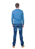 Back view of handsome man in blue pullover. Stock Images