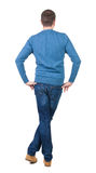 Back view of handsome man in blue pullover. Royalty Free Stock Photography