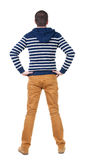 Back view of handsome man in blue striped sweater Stock Photos