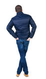 Back view of handsome man in blue windcheater looking. Stock Photos