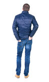 Back view of handsome man in blue windcheater looking Royalty Free Stock Images