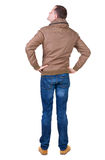 Back view of handsome man in brown windcheater looking up. Royalty Free Stock Images