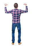 Back view of handsome man in checkered shirt keep on ha Stock Photography