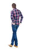 Back view of handsome man in checkered shirt  looking. Royalty Free Stock Image