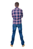 Back view of handsome man in checkered shirt  looking up. Standing young guy in jeans. Rear view people collection.  backside view of person.  Isolated over Royalty Free Stock Images