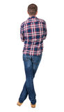Back view of handsome man in checkered shirt  looking up. Stock Photos