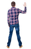 Back view of handsome man in checkered shirt  looking up. Standing young guy in jeans. Rear view people collection.  backside view of person.  Isolated over Stock Image