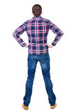Back view of handsome man in checkered shirt  looking up. Royalty Free Stock Image