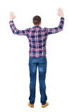 Back view of handsome man in checkered shirt  lwaving from his h. Ands. Standing young guy in jeans. Rear view people collection.  backside view of person Royalty Free Stock Photography