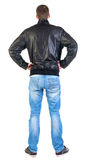 Back view of handsome man in jacket  looking up. Royalty Free Stock Photos