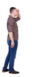 Back view of handsome man in shirt looking up. Stock Photos
