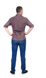 Back view of handsome man in shirt looking up. Royalty Free Stock Photography