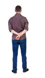 Back view of handsome man in shirt looking up. Standing young guy in jeans. Rear view people collection.  backside view of person.  Isolated over white Stock Images