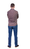 Back view of handsome man in shirt looking up. Stock Photo