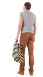 Back view of handsome man with shopping bags Royalty Free Stock Image