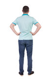 Back view of handsome man in t-shirt looking up. Royalty Free Stock Photos