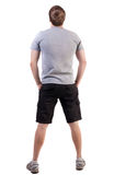 Back view of handsome man in t-shirt and  shorts  looking up Stock Photography