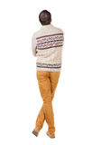 Back view of handsome man in warm sweater looking up Royalty Free Stock Image