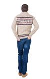 Back view of handsome man in warm sweater looking up. Royalty Free Stock Images