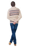 Back view of handsome man in warm sweater looking up. Stock Images