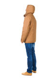 Back view of handsome man in winter jacket  looking up. Royalty Free Stock Image