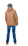 Back view of handsome man in winter jacket  looking up. Standing young guy in parka. Rear view people collection.  backside view of person.  Isolated over Royalty Free Stock Photos