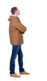 Back view of handsome man in winter parka looking Royalty Free Stock Image
