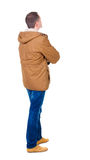 Back view of handsome man in winter parka looking Royalty Free Stock Images