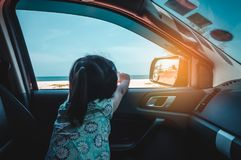 Asian girl enjoying while sitting in the car. Travel on vacation royalty free stock images