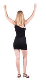 Back view of happy business woman in dress . Royalty Free Stock Images
