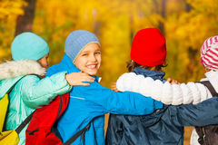 Back view of happy children with rucksacks Royalty Free Stock Image