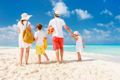 Family with kids on beach vacation royalty free stock images