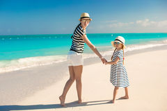 Back view of happy mother and little daughter at caribbean beach Royalty Free Stock Images